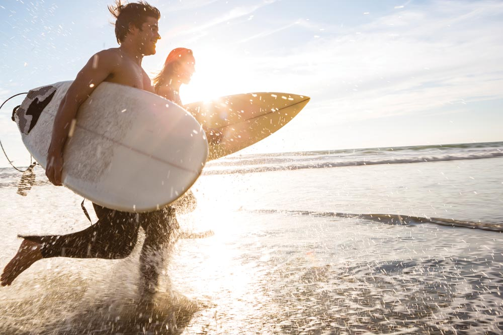 Enjoy a surf on the many beaches near Longlands Glamping