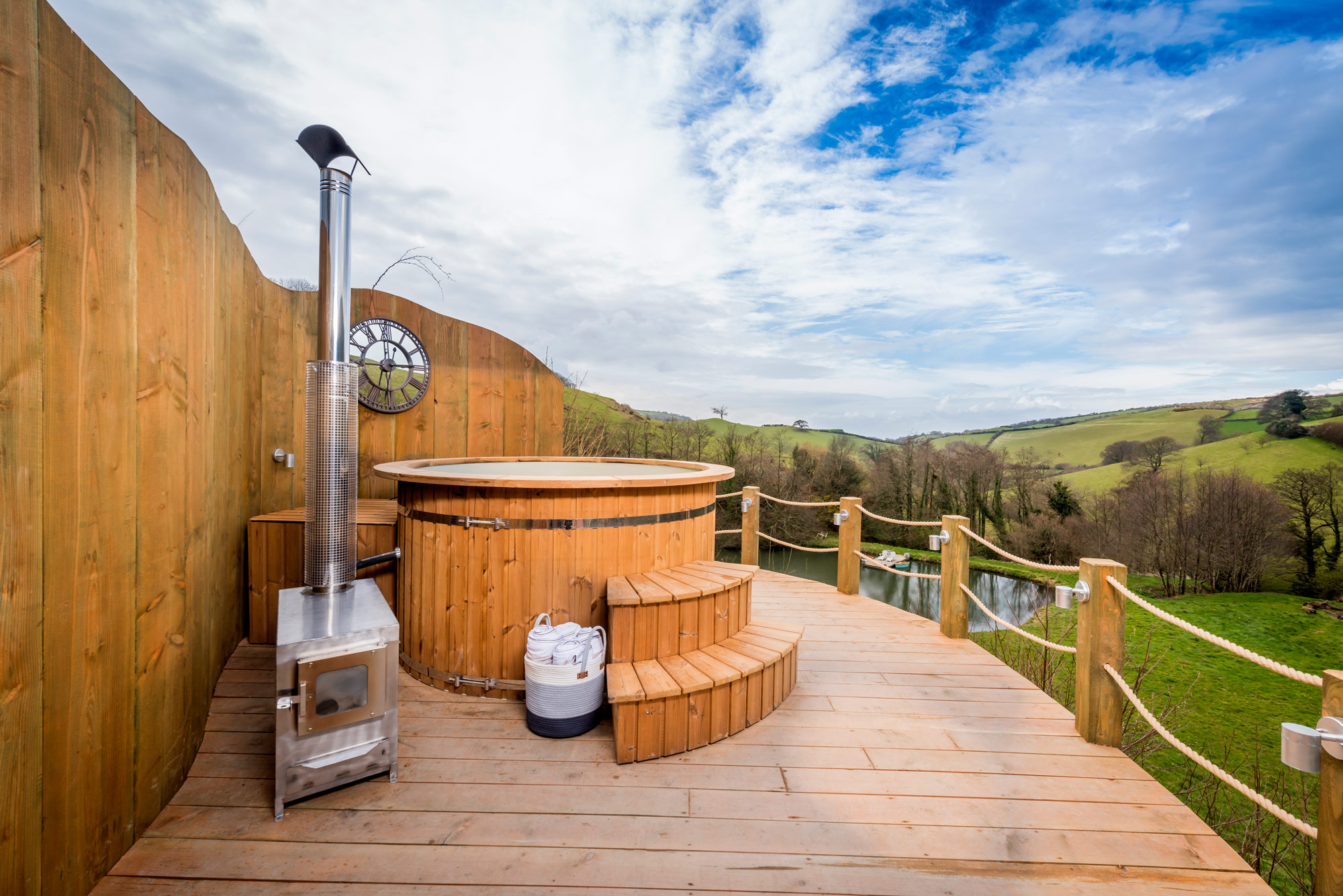 Experience glamping with a hot tub with stunning views at Longlands luxury glamping