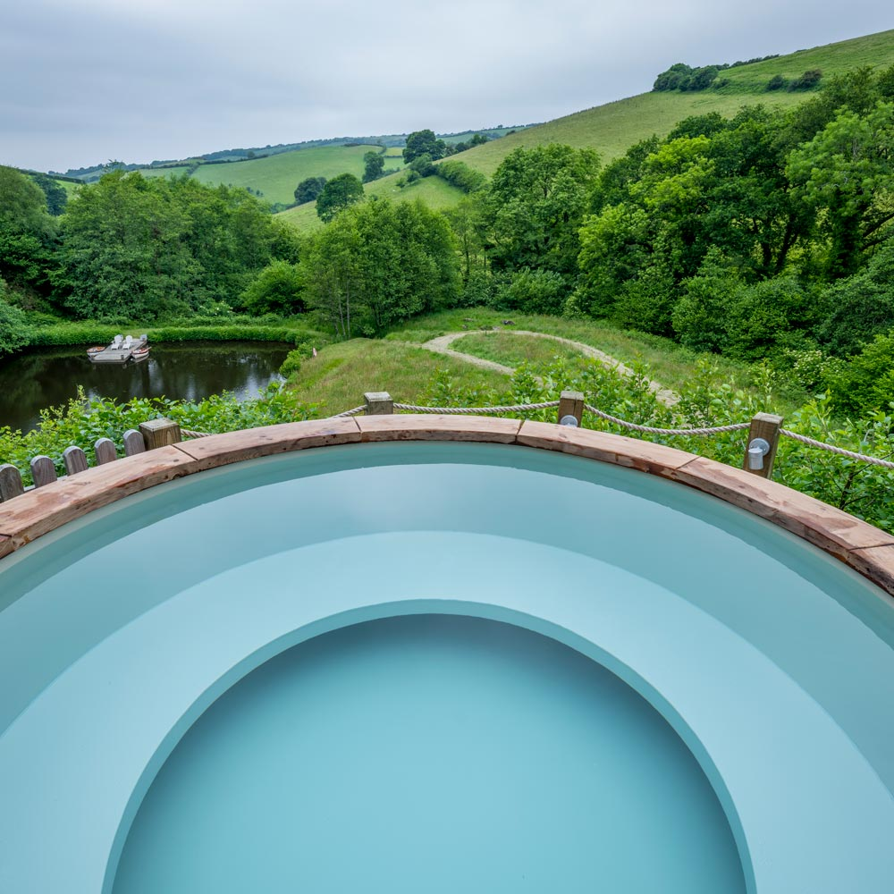Relaxing views from the hot tub at Longlands Luxury Glamping
